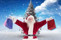 Санта Клаус держа сумки подарка рождества Стоковое Фото