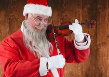 Санта Клаус играя скрипку Стоковая Фотография