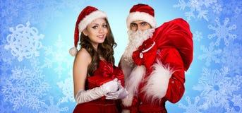 Санта Клаус и девушка xmas стоят совместно Стоковые Изображения