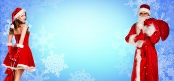 Санта Клаус и девушка xmas стоят совместно Стоковое Изображение RF