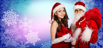 Санта Клаус и девушка xmas стоят совместно Стоковое Изображение