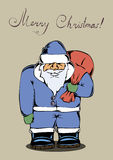 Санта Клаус носит сумку подарков Стоковое Фото
