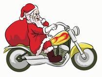 Санта Клаус освобождая мотоцикл Стоковая Фотография RF