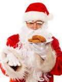 Санта Клаус с печеньями Стоковое Изображение