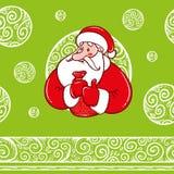 Санта Клаус с подарками и картиной Стоковое Изображение