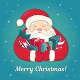 Санта Клаус с рождественской елкой и подарками в руках Стоковое фото RF
