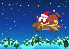 Санта Клаус с рождеством северного оленя двигателя Стоковое фото RF