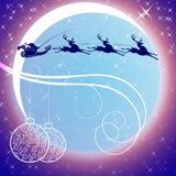 Санта Клаус с северным оленем на предпосылке луны Стоковое Изображение