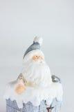 Санта Клаус с сумкой настоящих моментов в трубе стоковое фото