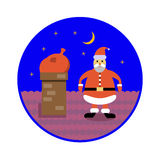 Санта Клаус с сумкой подарков сидит в печной трубе на крыше Стоковая Фотография RF