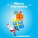 Санта носит подарки Стоковое Изображение RF