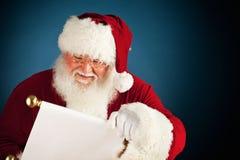 Санта: Список рождества чтения Стоковые Изображения