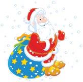 Санта с его сумкой подарка Стоковое фото RF