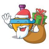 Санта с шаржем талисмана закручивая верхней части подарка иллюстрация штока