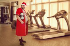 Санта хочет потерять некоторое сало Стоковые Фото