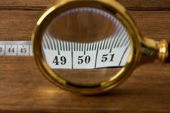 Сантиметр под лупой диетпитание принципиальной схемы Стоковые Фото