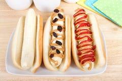 3 сандвича банана на плюшках хот-дога Стоковое фото RF