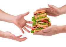 Сандвич в руках Стоковое Изображение RF