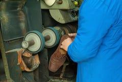 Сапожник с голубым пальто Стоковое Изображение RF