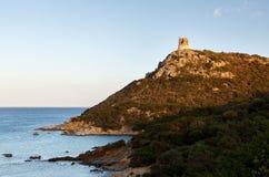 Сардиния, Италия - наблюдайте башню на заходе солнца стоковое изображение