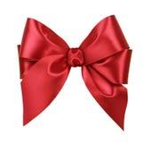 сатинировка красного цвета подарка смычка стоковые фотографии rf