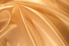 сатинировка предпосылки шикарная золотистая ровная Стоковая Фотография