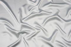 сатинировка серого цвета предпосылки Стоковое Фото