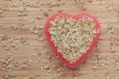 Сахара тросточки Брайна в шаре сердца Стоковые Фото