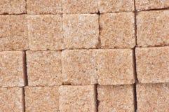 сахар кубиков предпосылки коричневый Стоковые Изображения RF