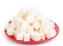 Сахар на красной плите стоковое фото rf