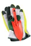 Садовые инструменты любят лопаткоулавливатель, перчатки на предпосылке изолированной белизной Стоковое Фото