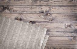 Салфетка на деревянной предпосылке Взгляд сверху Стоковое Фото