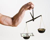 Сбалансируйте деньги стоковые фотографии rf