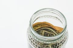 Сбережения раздражают с деньгами США с простой предпосылкой Стоковая Фотография RF