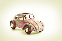 сбор винограда игрушки автомобиля розовый Стоковое Изображение