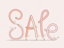 сбывание Смешное ` продажи ` текста состоя из карандашей на розовой предпосылке стоковые фото