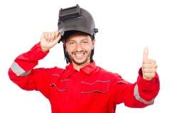 Сварщик в красных прозодеждах Стоковая Фотография