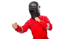 Сварщик в красных прозодеждах Стоковое Фото
