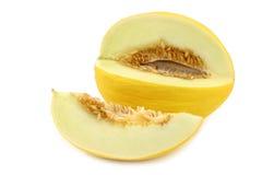 Свежая желтая дыня меда и отрезок соединяют стоковая фотография rf