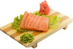 Свежая сырцовая salmon рыба соединяет на изолированной плите Стоковое Фото