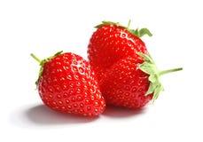 Свежие красные клубники на белой предпосылке Стоковое Фото