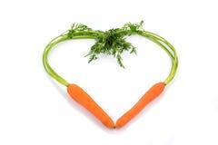 Свежие моркови в форме сердца Стоковые Изображения RF