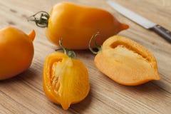 Свежие оранжевые томаты перца Стоковые Фото