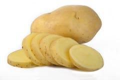 Свежие отрезанные картошки на белизне Стоковые Фото