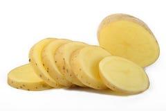 Свежие отрезанные картошки на белизне Стоковая Фотография