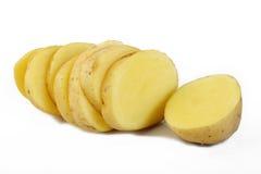 Свежие отрезанные картошки на белизне Стоковые Изображения RF