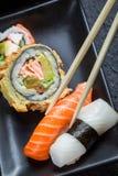 Свежие суши съеденные с палочками Стоковое фото RF