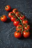 Свежие томаты вишни на каменной предпосылке Стоковая Фотография