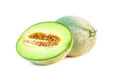 Свежие фрукты дыни одиночные и половинные Стоковое Изображение