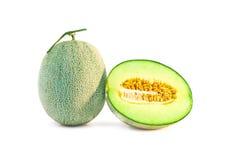 Свежие фрукты дыни одиночные и половинные Стоковые Фотографии RF